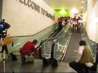 Before our mall was opened officially to the public, we gathered at the travelator, pretending to surf.