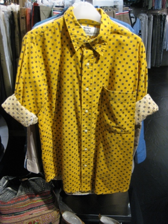 Red long-sleeved shirt created with mixed-garment pattern and yellow long-sleeved shirt with small square pattern. (Each at SD$42.90)