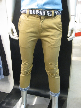 Beige pants with few specially designed patterns at the end of the legs and behind. (SD55.90)