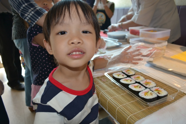 Our little shopper proudly showing us his sushi creations!